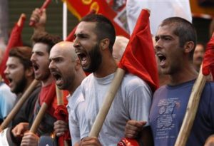 Protesters from the communist-affiliated trade union PAME shout slogans during a rally in the city of Thessaloniki